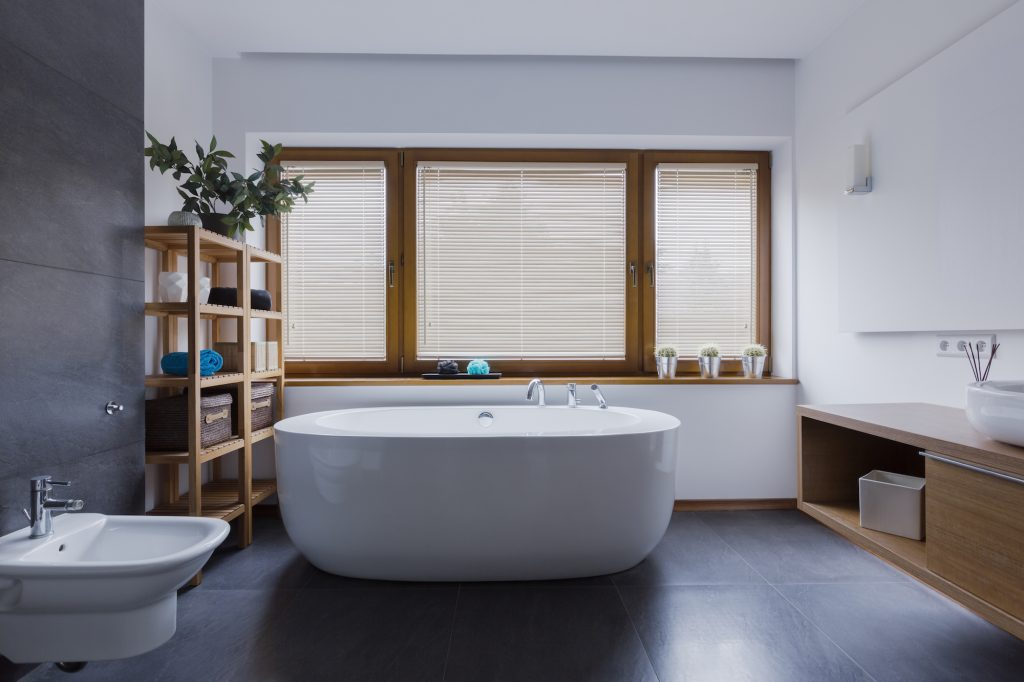 Modern bathroom with open shelving unit and other DIY bathroom ideas